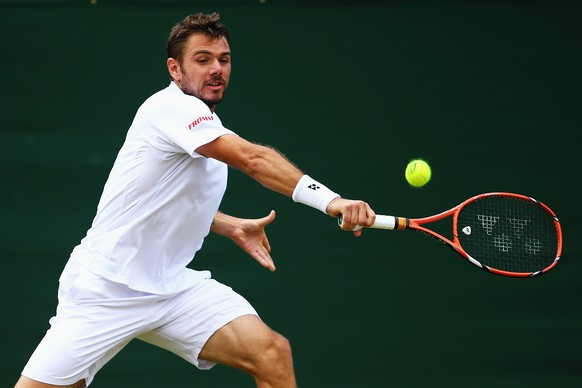 LONDON, ENGLAND - JUNE 30:  Stan Wawrinka of Switzerland during his Gentlemen's Singles third round match against Denis Istomin of Uzbekistan on day seven of the Wimbledon Lawn Tennis Championships at the All England Lawn Tennis and Croquet Club on June 30, 2014 in London, England.  (Photo by Al Bello/Getty Images)