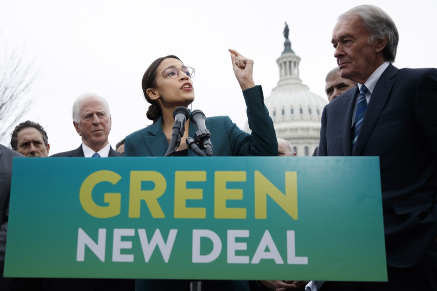 epaselect epa07351016 Democratic Representative from New York Alexandria Ocasio-Cortez (L), with US Democratic Senator from Massachusetts Ed Markey (R), delivers remarks on the 'Green New Deal' resolution during a press conference on Capitol Hill in Washington, DC, USA, 07 February 2019. The resolution emphasizes massive public investment in wind and solar production, zero-emission vehicles and high-speed rail, energy-efficient buildings, and smart power grids, as well as 'working collaboratively' with farmers and ranchers to move towards sustainable agriculture techniques.  EPA/SHAWN THEW