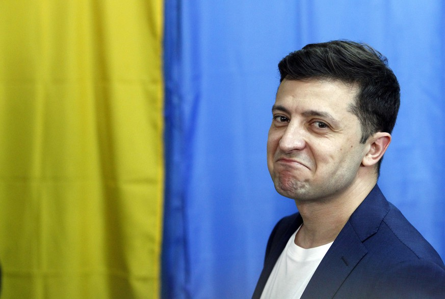 epa07519094 Ukrainian Presidential candidate Volodymyr Zelensky reacts as casts his ballot at a polling station during Presidential elections in Kiev, Ukraine, 21 April 2019. Ukrainians vote in the second round of Presidential elections on 21 April 2019. After the first round of elections, showman Volodymyr Zelensky is a frontrunner with 30.24 percent of votes and incumbent president Petro Poroshenko is a runner-up with 15.95 percent of votes.  EPA/STEPAN FRANKO