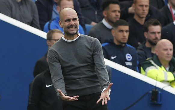 Manchester City coach Pep Guardiola gestures during the English Premier League soccer match between Brighton and Manchester City at the AMEX Stadium in Brighton, England, Sunday, May 12, 2019. (AP Photo/Frank Augstein)