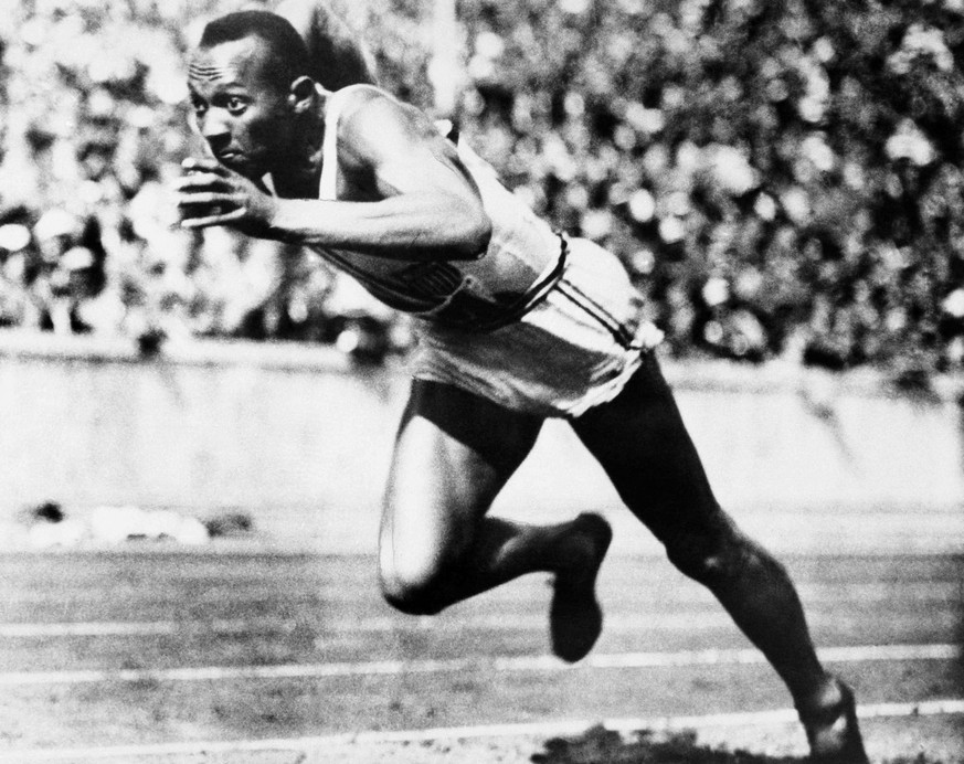 This is an Aug. 14, 1936, file photo showing Jesse Owens competing in one of the heats of the 200-meter run at the 1936 Olympic Games in Berlin. The performance of Jesse Owens will be honored in the stadium where he won four gold medals at the 1936 Olympic Games when the world championships are held in Berlin this month. (AP Photo)