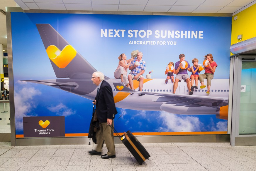 epa07864111 A man walks past a Thomas Cook advertising board at Gatwick Airport in Sussex, England, Britain, 23 September 2019. More than 600,000 vacation reservations were canceled on 23 September, after Thomas Cook ceased to operate. According to media reports, the company's collapse will see Britain's largest peace time repatriation take place to get stranded customers home.  EPA/VICKIE FLORES