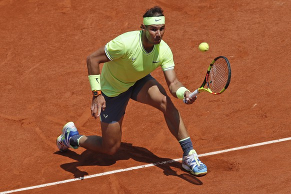 Spain's Rafael Nadal plays a shot against Germany's Yannick Maden during their second round match of the French Open tennis tournament at the Roland Garros stadium in Paris, Wednesday, May 29, 2019. (AP Photo/Christophe Ena)