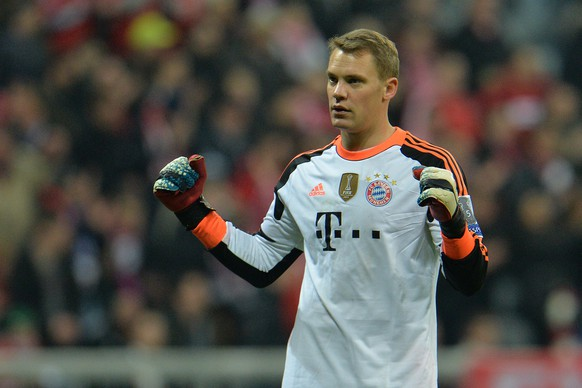 Bayern's goalkeeper Manuel Neuer celebrates after the Champions League round of the last 16 second leg soccer match between FC Bayern Munich and Arsenal FC in Munich, Germany, on Tuesday, March 11. 2014. The match finished 1:1. (AP Photo/Kerstin Joensson)