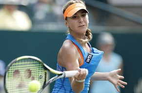 Belinda Bencic, of Switzerland, returns to Jana Cepelova, of Slovakia, during the Family Circle Cup tennis tournament in Charleston, S.C., Saturday, April 5, 2014. Cepelova won 6-4, 5-7, 7-6 (7), to reach the finals. (AP Photo/Mic Smith)