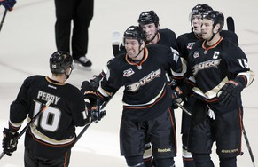 Anaheim Ducks defenseman Francois Beauchemin, second from left, celebrates his goal with right wing Corey Perry (10), left wing Matt Beleskey, defenseman Ben Lovejoy, second from right, and center Ryan Getzlaf (15) in the third period of an NHL hockey game against Edmonton Oilers on Wednesday, April 2, 2014, in Anaheim, Calif. The Ducks won 3-2. (AP Photo/Alex Gallardo)