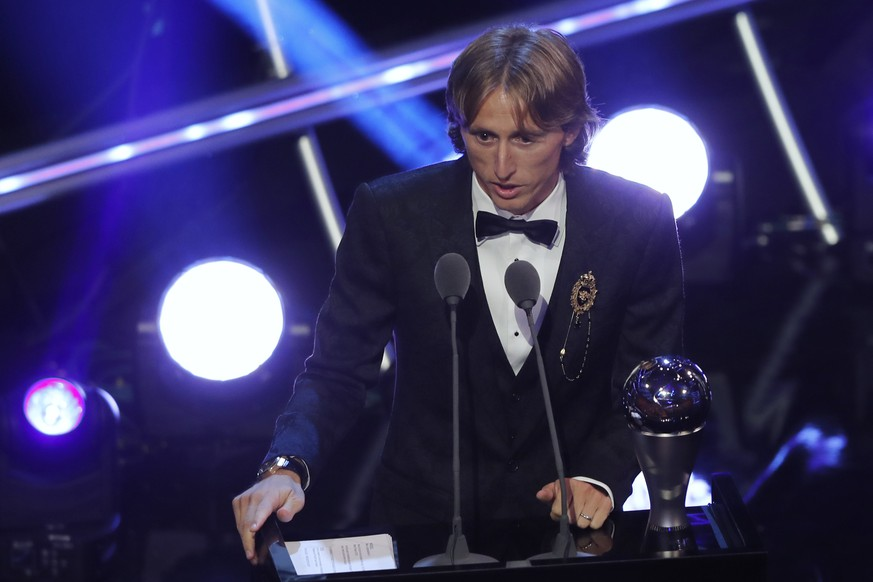Crotia's Luka Modric receives the Best FIFA Men's Player award during the ceremony of the Best FIFA Football Awards in the Royal Festival Hall in London, Britain, Monday, Sept. 24, 2018. (AP Photo/Frank Augstein)