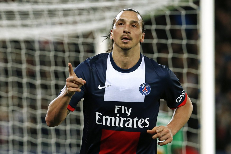 Paris St Germain's Zlatan Ibrahimovic celebrates after scoring against St Etienne during their French Ligue 1 soccer match at the Parc des Princes Stadium in Paris, March 16, 2014. REUTERS/Benoit Tessier (FRANCE - Tags: SPORT SOCCER)