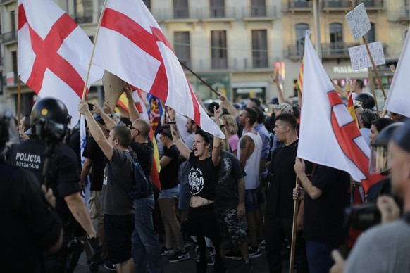 Far-right protesters shout slogans after a van attack in Barcelona, Spain, Friday Aug. 18, 2017. Police on Friday shot and killed five people carrying bomb belts who were connected to the Barcelona van attack, as the manhunt intensified for the perpetrators of Europe's latest rampage claimed by the Islamic State group. (AP Photo/Emilio Morenatti)