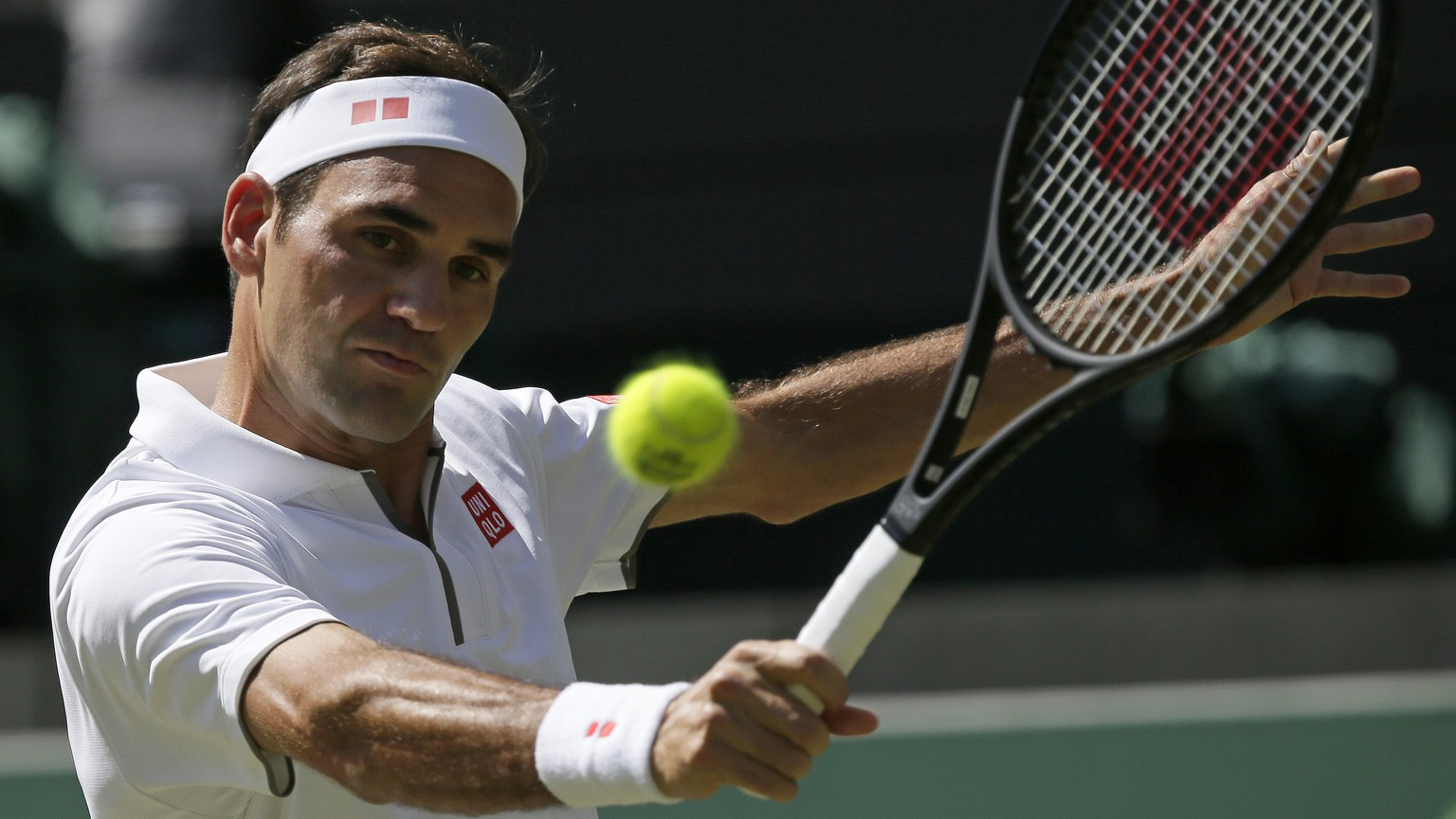 Switzerland's Roger Federer returns to Britain's Jay Clarke in a Men's singles match during day four of the Wimbledon Tennis Championships in London, Thursday, July 4, 2019. (AP Photo/Tim Ireland)