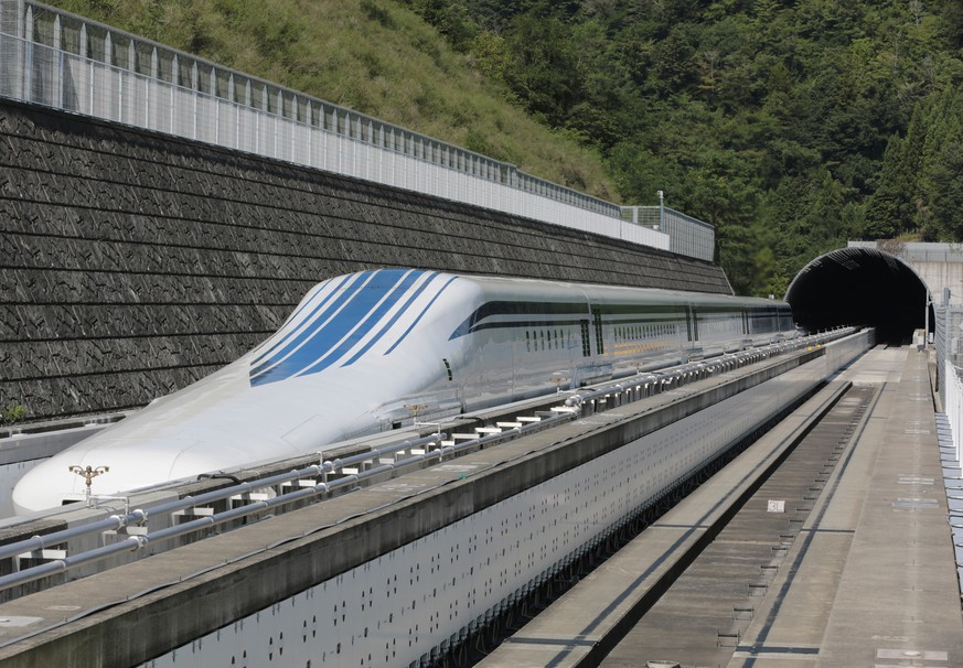 The L0 (L zero) series magnetic-levitation train, developed by Central Japan Railway Co., sits parked on a test track at the control center before a trial run in Tsuru City, Yamanashi Prefecture, Japan, on Thursday, Aug. 29, 2013. Japan resumed trial runs for the world's fastest magnetic-levitation train that will complement the Shinkansen bullet-train network when ready in 2027. Photographer: Yuriko Nakao/Bloomberg