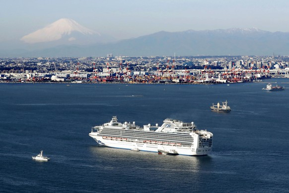 Cruise ship Diamond Princess is anchored off the shore of Yokohama, south of Tokyo, Wednesday, Feb. 5, 2020. Japan said Wednesday 10 people on the cruise ship have tested positive for a new virus and were being taken to hospitals. Health Minister Nobukatsu Kato said all the 3,700 people and passengers on the ship will be quarantined on board for up to 14 days under Japanese law. (Hiroko Harima/Kyodo News via AP)