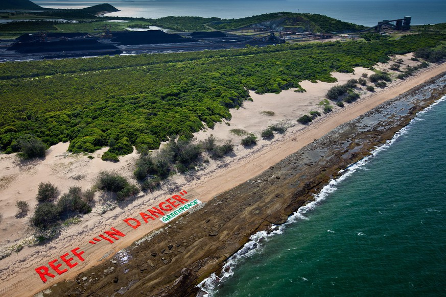 epa04050298 A handout picture made available by Greenpeace on 01 February 2014 shows a signage of a protest against the proposed coal port at Abbot Point, reading 'Reef In Danger', at the Great Barrier Reef, north of Bowen, Queensland, Australia, 11 December 2013. According to media reports on 01 February 2014, Environmentalists expressed concern for the future of the Great Barrier Reef after a decision to dump dredged material inside the protected coral reef marine park. Up to 3 million cubic metre of sludge will be dumped inside the marine park as part of a plan to expand a coastal port for the export of coal. The Great Barrier Reef Marine Park Authority approved the plan on 31 January 2014, saying the sludge will be dumped well away from reefs and won't impact on the world famous coral. The dredging plan is supported by the Australian government.  EPA/GREENPEACE AUSTRALIA AND NEW ZEALAND OUT HANDOUT EDITORIAL USE ONLY
