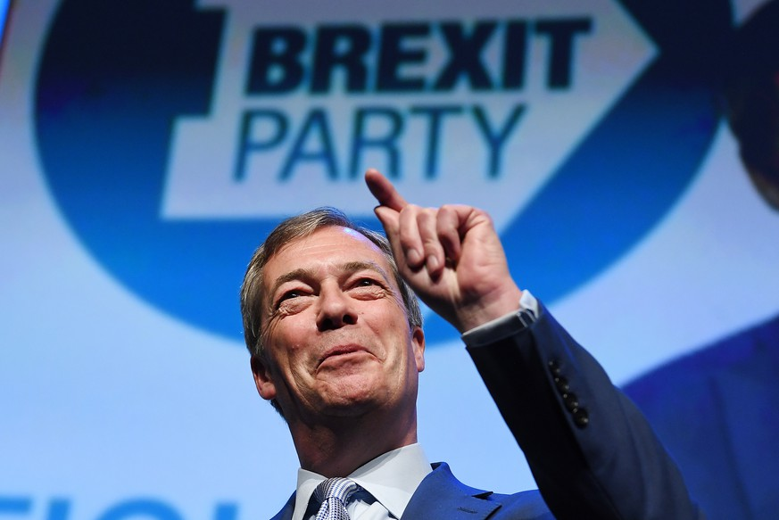 epa07503826 Brexit Party leader Nigel Farage speaks at a Brexit Party rally in Birmingham, Britain, 13 April 2019. Farage launched his new political party, the Brexit Party, in Coventry on 12 April 2019.  EPA/ANDY RAIN
