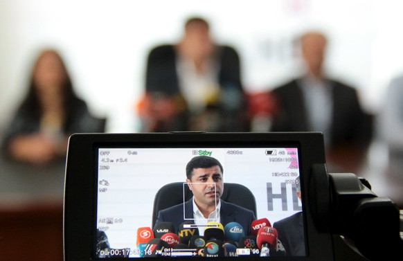 Selahattin Demirtas, co-chairman of Turkey's pro-Kurdish Peoples' Democratic Party (HDP), is seen on a video camera screen during a news conference in Diyarbakir, Turkey, September 9, 2015. It is