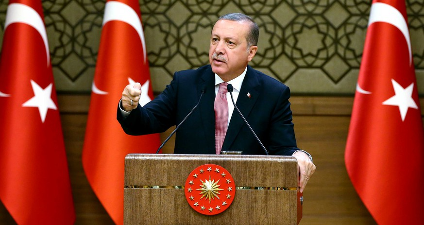 Turkey's President Recep Tayyip Erdogan speaks during an event for foreign investors, in Ankara, Turkey, on Tuesday, Aug. 2, 2016. Erdogan said, once more blasted unnamed Western countries which he says supported an attempted coup on July 15 which left more than 270 people dead.