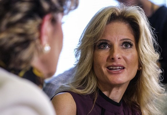 Summer Zervos, right, speaks alongside her attorney Gloria Allred during a news conference in Los Angeles, Friday, Oct. 14, 2016. Zervos, a former contestant on