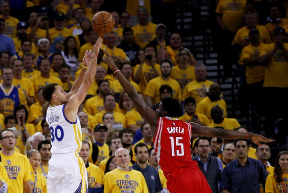 OAKLAND, CA - MAY 19:  Stephen Curry #30 of the Golden State Warriors shoots against Clint Capela #15 of the Houston Rockets in the second quarter during Game One of the Western Conference Finals of the 2015 NBA Playoffs at ORACLE Arena on May 19, 2015 in Oakland, California.  (Photo by Ezra Shaw/Getty Images)