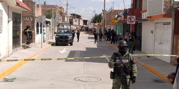 epa08470679 Members of the National Guard protect the area where ten people were killed in the municipality of Irapuato, Guanajuato state, Mexico, 06 June 2020. Ten people were shot dead in a drug addiction rehabilitation center in the central state of Guanajuato.  EPA/STR