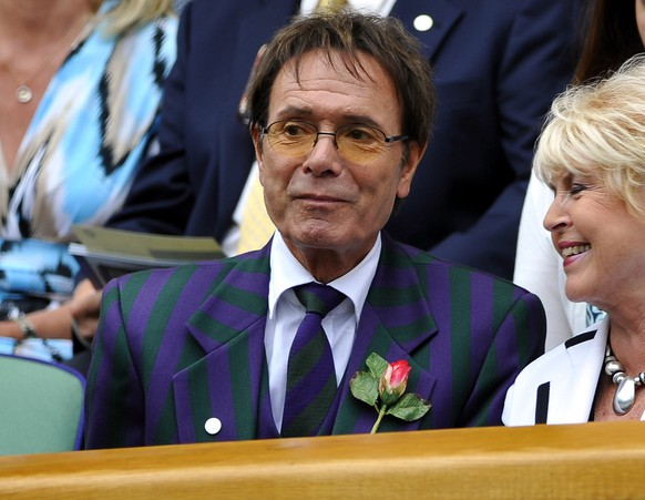 epa04353225 (FILES) British singer Cliff Richard on Centre Court for the women's semi finals of the Wimbledon Championships at the All England Lawn Tennis Club, in London, Britain, 30 June 2011.  It was reported 14 August 2014 that police are searching a property belonging to Sir Cliff Richard in relation to an alleged historical sex offence. Items were removed from the property for further investigation, but no arrests have been made.  EPA/NEIL MUNNS *** Local Caption *** 02802648