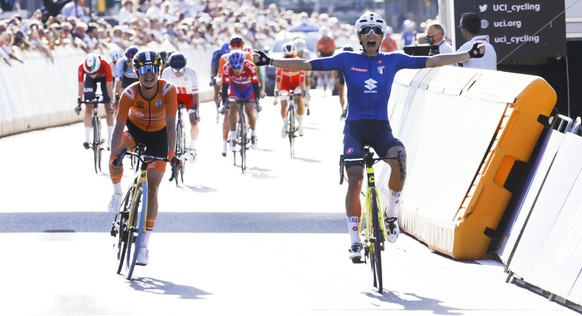 Elisa Balsamo of Italy crosses the finish line ahead of Marianne Vos of The Netherlands to win the women's road race of the World Road Cycling Championships in Leuven, Belgium, Saturday, Sept. 25, 2021. (AP Photo/Olivier Matthys)