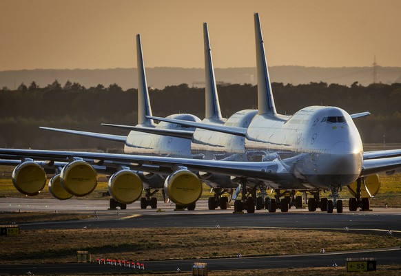 Boeing 747 aircrafts of German Lufthansa are parked at the airport in Frankfurt, Germany, Monday, April 20, 2020. Due to the coronavirus Lufthansa had to cancel 97 percent of its flights. (AP Photo/Michael Probst)