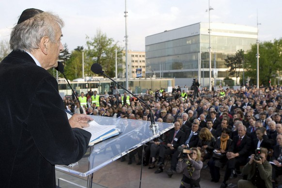Nobel peace laureate Elie Wiesel delivers a statement during a ceremony to mark Israel's Holocaust day at the Place de la Nation, outside the UN headquarters in Geneva, Switzerland, Monday, April 20, 2009. Iranian President Mahmoud Ahmadinejad has accused Israel of being the