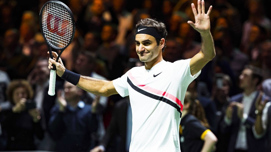epa06540080 Roger Federer of Switzerland celebrates after defeating Grigor Dimitrov of Bulgaria in their final match of the ABN Amro World Tennis Tournament in Rotterdam, Netherlands, 18 February 2018.  EPA/KOEN SUYK