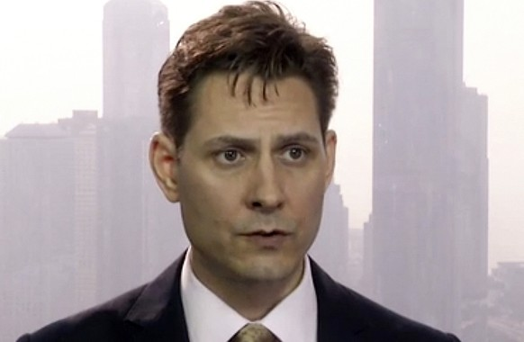 FILE - In this March 28, 2018, file imag made from video, Michael Kovrig, an adviser with the International Crisis Group, a Brussels-based non-governmental organization, speaks during an interview in Hong Kong. China has charged two detained Canadians with spying in cases linked to Canada