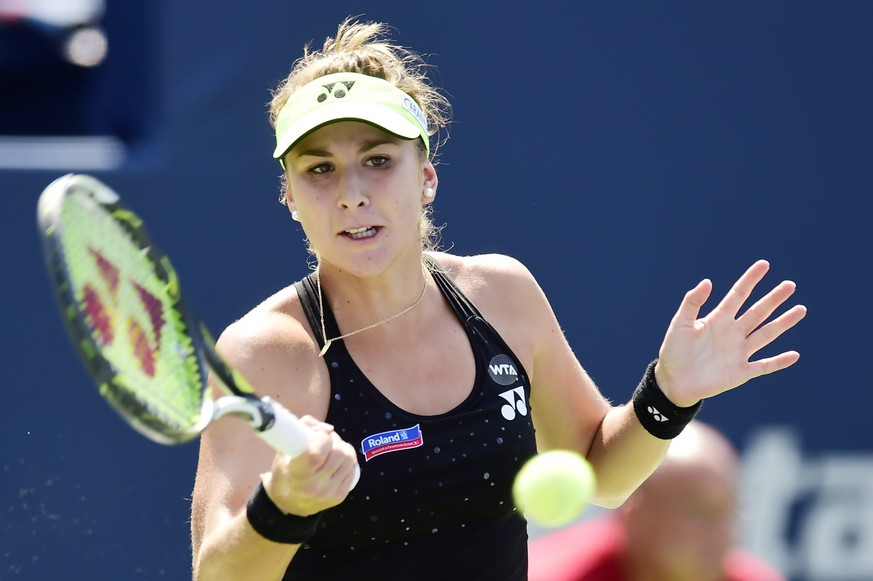 Belinda Bencic, of Switzerland, hits a return to Simona Halep, of Romania, during the women's final at the Rogers Cup tennis tournament in Toronto, Sunday, Aug. 16, 2015. (Frank Gunn/The Canadian Press via AP)
