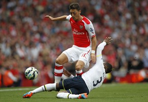"Arsenal's German midfielder Mesut Ozil (L) is tackled by Tottenham Hotspur's English defender Danny Rose during the English Premier League football match between Arsenal and Tottenham Hotspur at The Emirates Stadium in London on on September 27, 2014.  AFP PHOTO/IAN KINGTON - RESTRICTED TO EDITORIAL USE. No use with unauthorized audio, video, data, fixture lists, club/league logos or ""live"" services. Online in-match use limited to 45 images, no video emulation. No use in betting, games or single club/league/player publications."