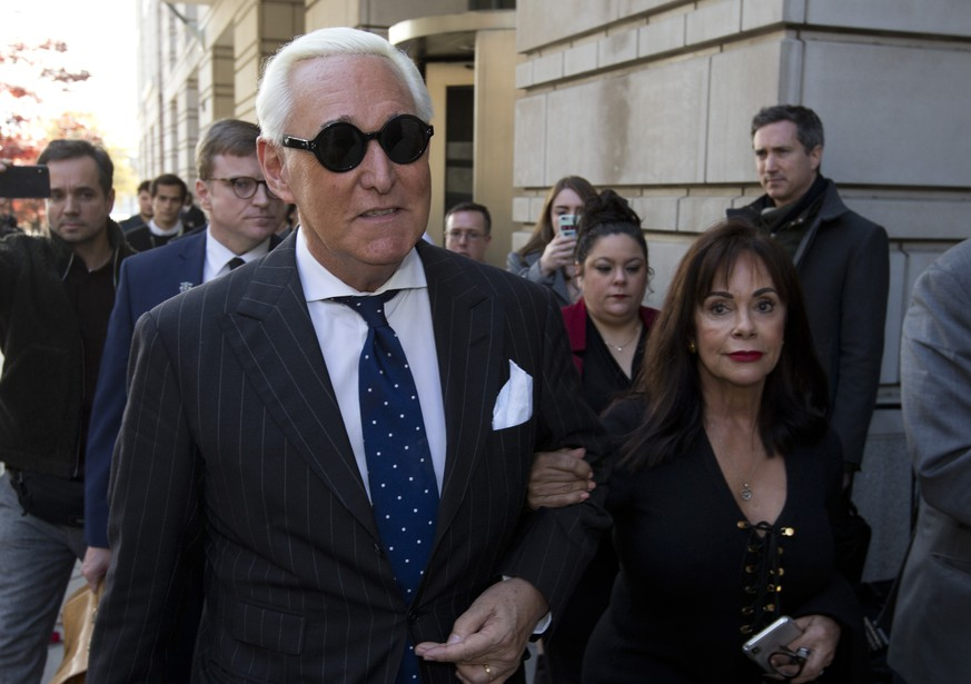 Roger Stone, left, with his wife Nydia Stone, leaves federal court in Washington, Friday, Nov. 15, 2019. Stone, a longtime friend of President Donald Trump, has been found guilty at his trial in federal court in Washington. (AP Photo/Jose Luis Magana)