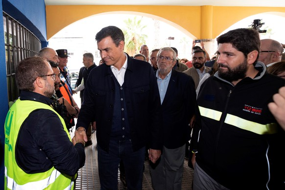 epa07842214 Acting Spanish Prime Minister Pedro Sanchez (C) visits the flooded region of Los Alcaceres, Murcia, eastern Spain, 14 September 2019. A total of six people have died due to the 'gota fria' (cold drop) phenomenon in the Mediterranean coast. The eastern regions of Valencia and Alicante continue under red level alert due to torrential rains while the State Meteorological Agency AEMET has reduced the alert in Murcia to orange level.  EPA/MARCIAL GUILLEN