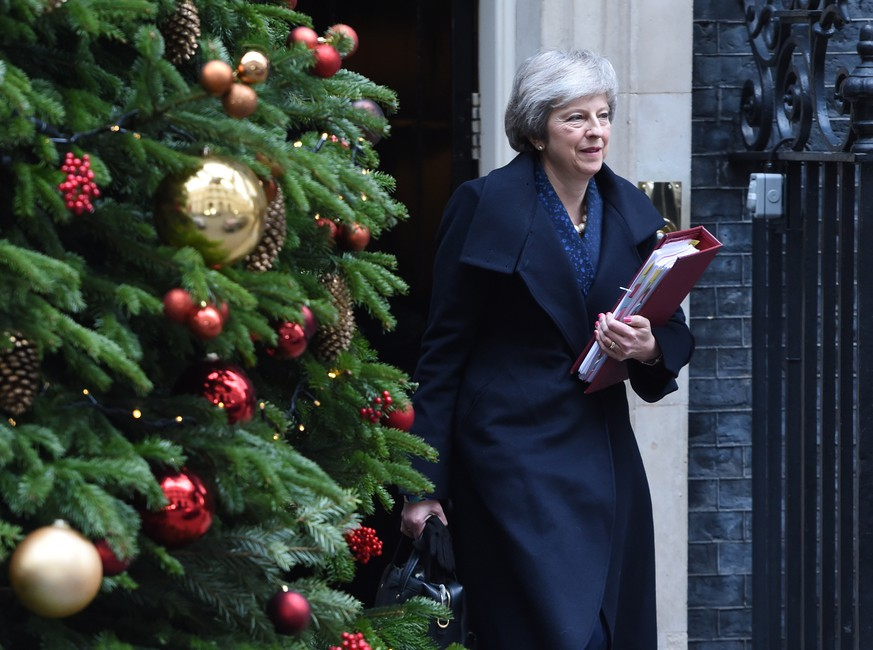 epa07225502 British Prime Minister Theresa May leaves 10 Downing street in London, Britain, 12 December 2018, to attend Prime Ministers Questions in the Houses of Parliament. Theresa May will face a challenge to her leadership on 12 December 2018 after 48 letters calling for a contest were delivered to the Chariman of the 1922 Committee. May will find out her future after Conservative Members of Parliament vote between 18:00 GMT and 20:00 GMT later in the evening.  EPA/FACUNDO ARRIZABALAGA