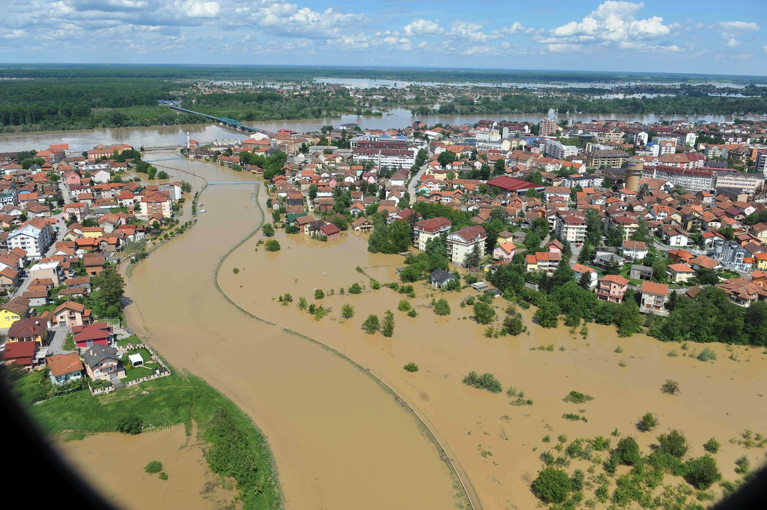 This image taken on taken Sunday, May 18, 2014 and made available by the Bosnia Army shows an aerial view of the flooded area near the Bosnian town of Brcko along the river Sava, 200 kms north of Bosnian capital of Sarajevo. Three months' worth of rain fell on the Balkan region in three days, producing the worst floods since rainfall measurements began 120 years ago. (AP Photo/Bosnia Army)