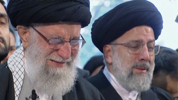 In this image taken from video, Iranian Supreme Leader Ayatollah Ali Khamenei, left, openly weeps as he leads a prayer over the coffin of Gen. Qassem Soleimani, who was killed in Iraq in a U.S. drone strike on Friday, at the Tehran University campus, in Tehran, Iran, Monday, Jan. 6, 2020. (Iran Press TV via AP)