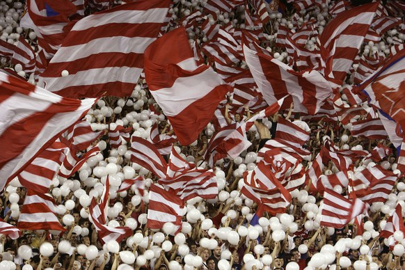 Red Star Belgrade fans wave red and white balloons and flags before the UEFA Champions League third qualifying round soccer match between Red Star and Glasgow Rangers, Belgrade, Serbia, Tuesday, Aug. 28, 2007. (AP Photo/Srdjan Ilic)