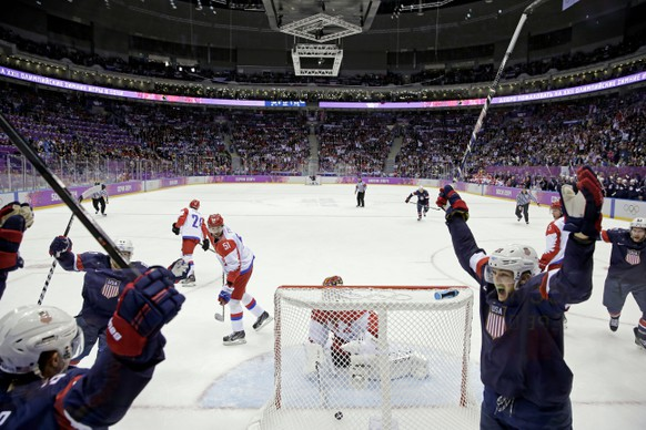 USA defenseman Cam Fowler, left, celebrates after scoring a goal on Russia goaltender Sergei Bobrovski during the second period of a men's ice hockey game at the 2014 Winter Olympics, Saturday, Feb. 15, 2014, in Sochi, Russia. (AP Photo/Mark Humphrey )