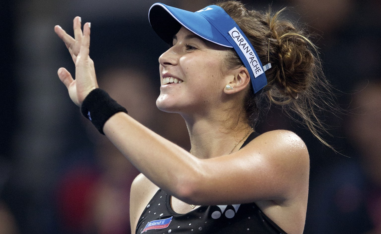 Belinda Bencic of Switzerland gestures to spectators after defeating Madison Brengle of the United States in their first round of the China Open tennis tournament at the National Tennis Stadium in Beijing, Monday, Oct. 5, 2015. (AP Photo/Andy Wong)