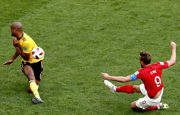epa06888259 Harry Kane of England (R) and Vincent Kompany of Belgium in action during the FIFA World Cup 2018 third place soccer match between Belgium and England in St.Petersburg, Russia, 14 July 2018.  (RESTRICTIONS APPLY: Editorial Use Only, not used in association with any commercial entity - Images must not be used in any form of alert service or push service of any kind including via mobile alert services, downloads to mobile devices or MMS messaging - Images must appear as still images and must not emulate match action video footage - No alteration is made to, and no text or image is superimposed over, any published image which: (a) intentionally obscures or removes a sponsor identification image; or (b) adds or overlays the commercial identification of any third party which is not officially associated with the FIFA World Cup)  EPA/ANATOLY MALTSEV EDITORIAL USE ONLY  EDITORIAL USE ONLY
