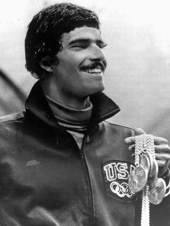 In this August 31, 1972, photo, American swimmer Mark Spitz holds five of the seven gold medals he won at the Olympics in Munich, Germany. In an interview Wednesday, July 2, 2008, with The Associated Press, the star of the 1972 Munich Games left little doubt that he expects his 36-year-old mark to be on the Olympic books for only another month or so. Michael Phelps will attempt to break Spitz's record of seven gold medals at the Olympics in Beijing. (AP Photo/Pool)