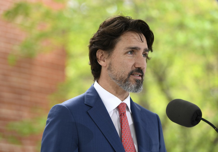 Canadian Prime Minister Justin Trudeau speaks during his daily news conference on the COVID-19 pandemic outside his residence at Rideau Cottage in Ottawa, Ontario, on Tuesday, May 19, 2020. (Justin Tang/The Canadian Press via AP) Justin Trudeau