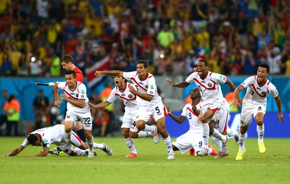RECIFE, BRAZIL - JUNE 29:  Costa Rica celebrate after defeating Greece in a penalty shootout during the 2014 FIFA World Cup Brazil Round of 16 match between Costa Rica and Greece at Arena Pernambuco on June 29, 2014 in Recife, Brazil.  (Photo by Quinn Rooney/Getty Images)