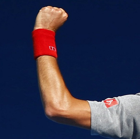 Serbia's Novak Djokovic raises his fists during a training session at the Rod Laver Arena in Melbourne Park January 18, 2015. The Australian Open tennis tournament begins on January 19. REUTERS/Issei Kato (AUSTRALIA - Tags: SPORT TENNIS)