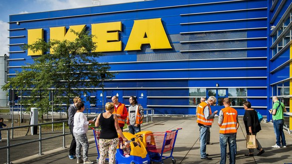 epa04354596 Activists from Dutch trade union FNV inform customers of IKEA about the alleged poor working conditions for the drivers of the retail in Haarlem, The Netherlands, 15 August 2014. The joint action of the trade unions FNV and BTB Belgium invited shoppers to send an email to IKEA to voice their concern. According to the unions, mostly Eastern European IKEA drivers are allegedly  being exploited  EPA/REMKO DE WAAL