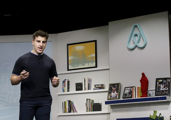 Airbnb co-founder and CEO Brian Chesky speaks during an announcement in San Francisco, Tuesday, April 19, 2016. Airbnb is adding new recommendations to its online accommodations service, building on its knowledge of travelers' preferences and tips from local residents. The company, which lets out-of-town visitors find people renting out homes and rooms, says it wants to help travelers get off the beaten path by showing alternatives to well-known, often crowded, attractions. (AP Photo/Jeff Chiu)