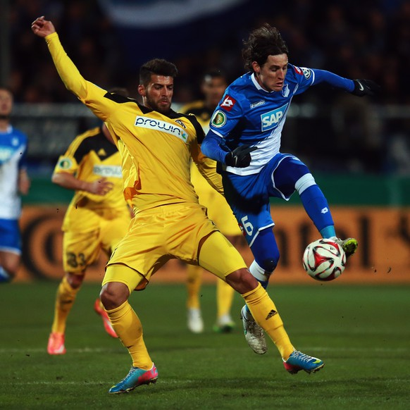 AALEN, GERMANY - MARCH 03: Juergen Gjasula (L) of Aalen is challenged by Sebastian Rudy of Hoffenheim during the DFB Cup Round of 16 match between VfR Aalen and 1899 Hoffenheim at Scholz Arena on March 3, 2015 in Aalen, Germany.  (Photo by Alex Grimm/Bongarts/Getty Images)