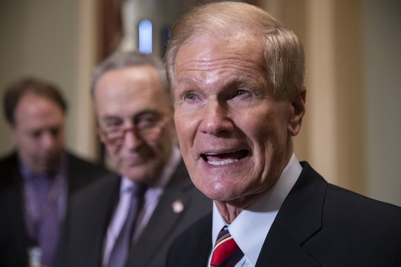 Sen. Bill Nelson, D-Fla., whose re-election contest against Republican Gov. Rick Scott is still undecided, is joined by Senate Minority Leader Chuck Schumer, D-N.Y., left, at a news conference at the Capitol in Washington, Tuesday, Nov. 13, 201816. (AP Photo/J. Scott Applewhite)