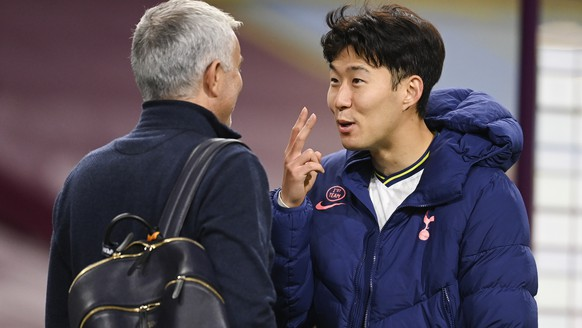Tottenham's Son Heung-min, right, talks with Tottenham's manager Jose Mourinho following the English Premier League soccer match between Burnley and Tottenham Hotspur at Turf Moor stadium Burnley, England, Monday, Oct. 26, 2020. (Michael Regan/Pool via AP)