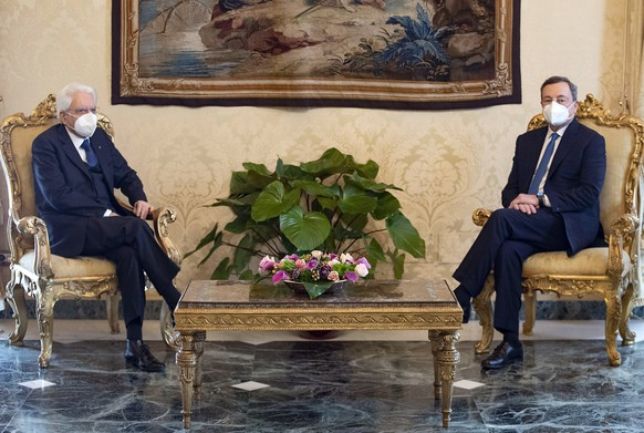 epa08983820 A handout photo made available by the press office of the Quirinal Palace (Palazzo Quirinale) shows former president of the European Central Bank (ECB) Mario Draghi meeting Italian President Sergio Mattarella (L) at the Quirinal Palace in Rome, Italy, 03 February 2021. President Mattarella has summoned Draghi for a meeting seeking for a 'high-profile' government. Mattarella, who said he was left with two choices, either calling snap elections or nominating a technical government, made the announcement after the ruling coalition failed to form a majority following Giuseppe Conte's resignation as prime minister.  EPA/QUIRINAL PALACE PRESS OFFICE HANDOUT  HANDOUT EDITORIAL USE ONLY/NO SALES
